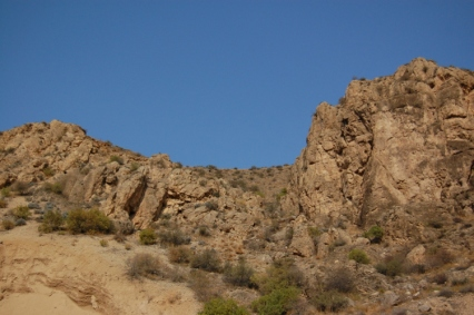 The craggy hills above the market.