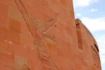 A woman representing revival on the rear of the memorial wall.